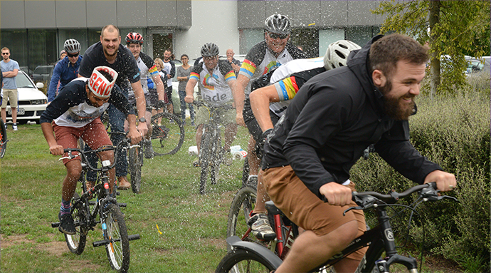 Jade's employees participating in Jade Bike Week just outside the Christchurch Office