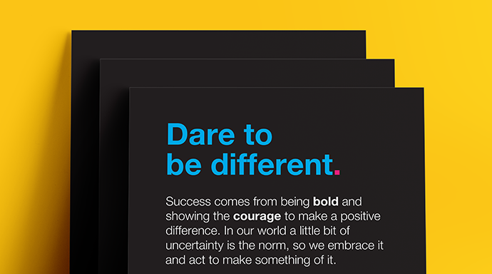One of Jade's values, Dare to be different, displayed on black card with a explaination of what the value means